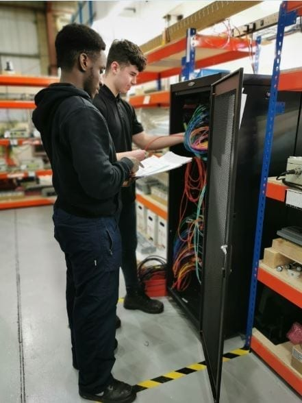 Our newest apprentices working with an AGI cabinet.