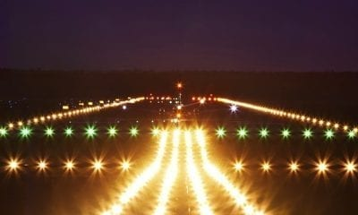 Commercial Airplane landing on runway